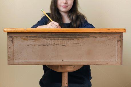 Girl Sitting At Desk (80301)