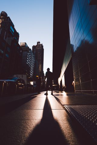 Man walking on a city sidewalk