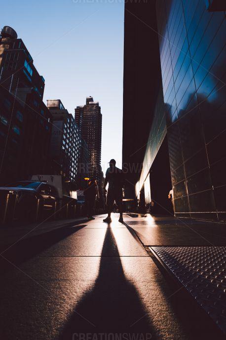Man walking on a city sidewalk (80359)