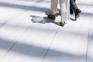 Legs of a couple walking