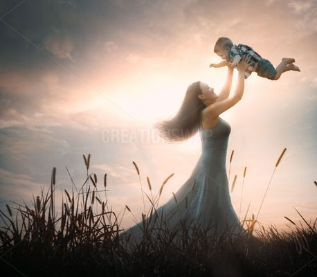 A mother lifts up her son (82635)