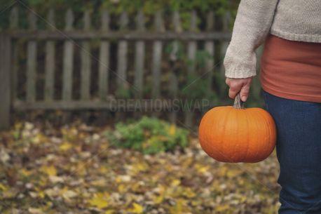 Woman Holding Pumpkin (83093)