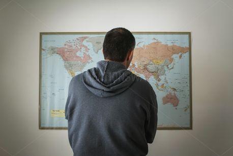 Man Looking At World Map (83517)