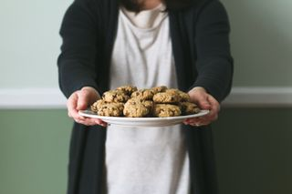 Woman Holding Cookies