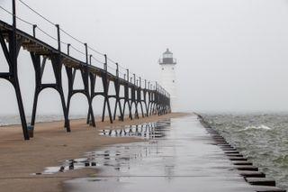 A lighthouse in fog