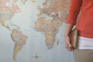 Woman Holding Bible and Map