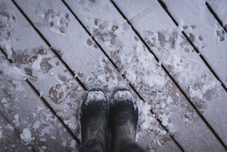 Boots on a snowy porch
