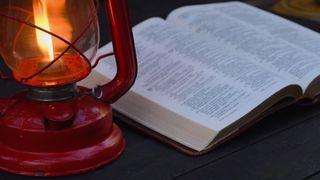 Flickering Lamp + Open Bible