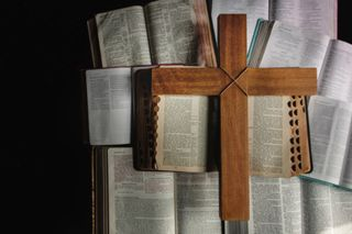 Open Bibles + Wooden Cross