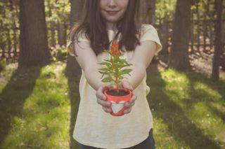 Girl Holding Flower Pot